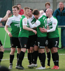 Celebration: The team congratulate Venables (Pic Chis Howells)