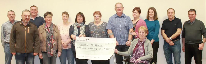 Successful bingo night: £840 cheque presented by the volunteers who organised the event