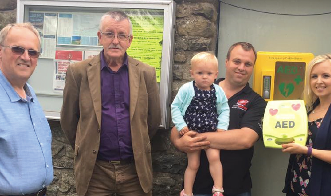 (L-R): Maes Glas Caravan Park owner Tim Hill, local County Councillor Gwyn James, Christopher Hill and daughter Katy, and Meinir Lewis from Welsh Hearts