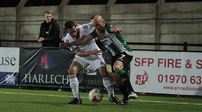 Geoff Kellaway: Battling with a Rhyl player to win the ball back for Aberystwth