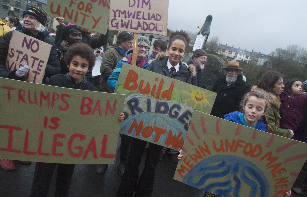 Protesting: (L-R) Osian Oyibo Goss, Maya Oyibo Goss, Lucy Goss holding banners (pic. Marc Hayes)